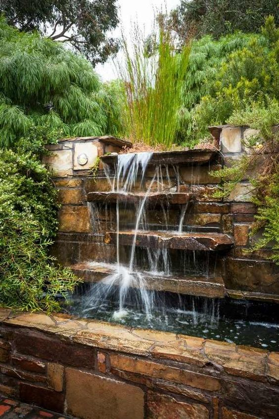 Water as an element of interior design in house for Artificial waterfalls design