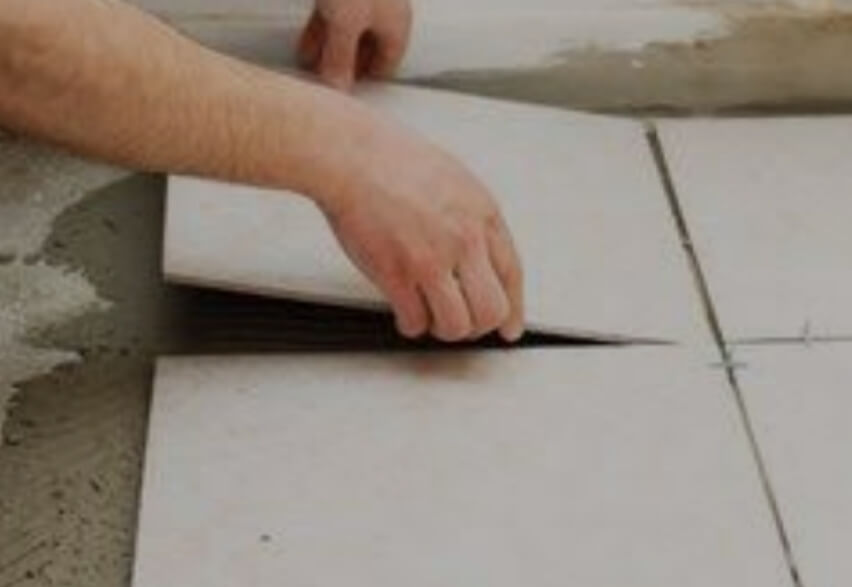 Laying of Vitrified tiles on motar laid