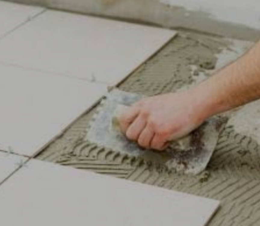Spreading of cement motar for laying tiles