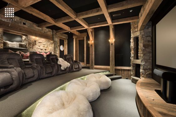 A Rustic Designed Home theatre with recliners and bean bags