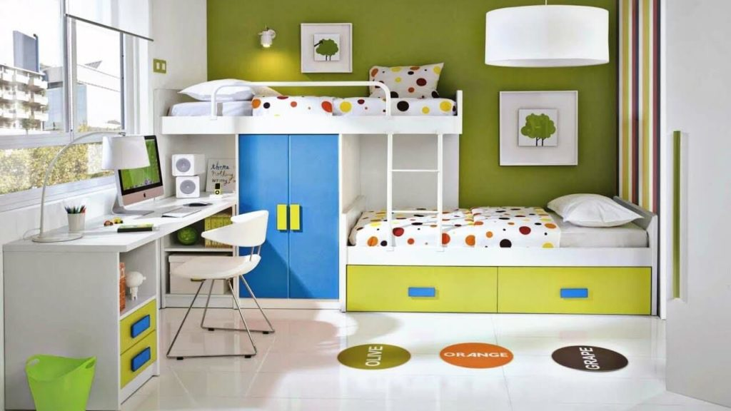 A colorful staggered bunk bed and a study table in kids room