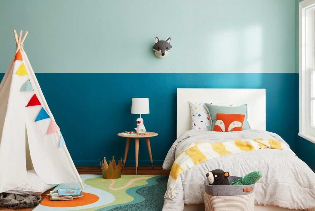 Kids room designed in calm colors like blue cyan and white with a tent placed inside