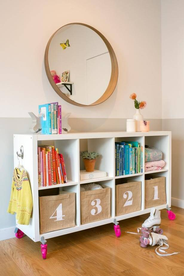 Open movable storage on wheels in kids room for storing books and toys