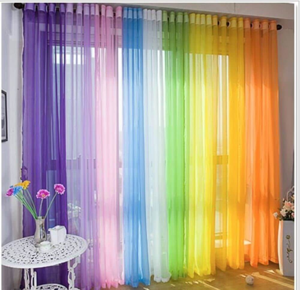 rainbow colored curtain in kids bedroom